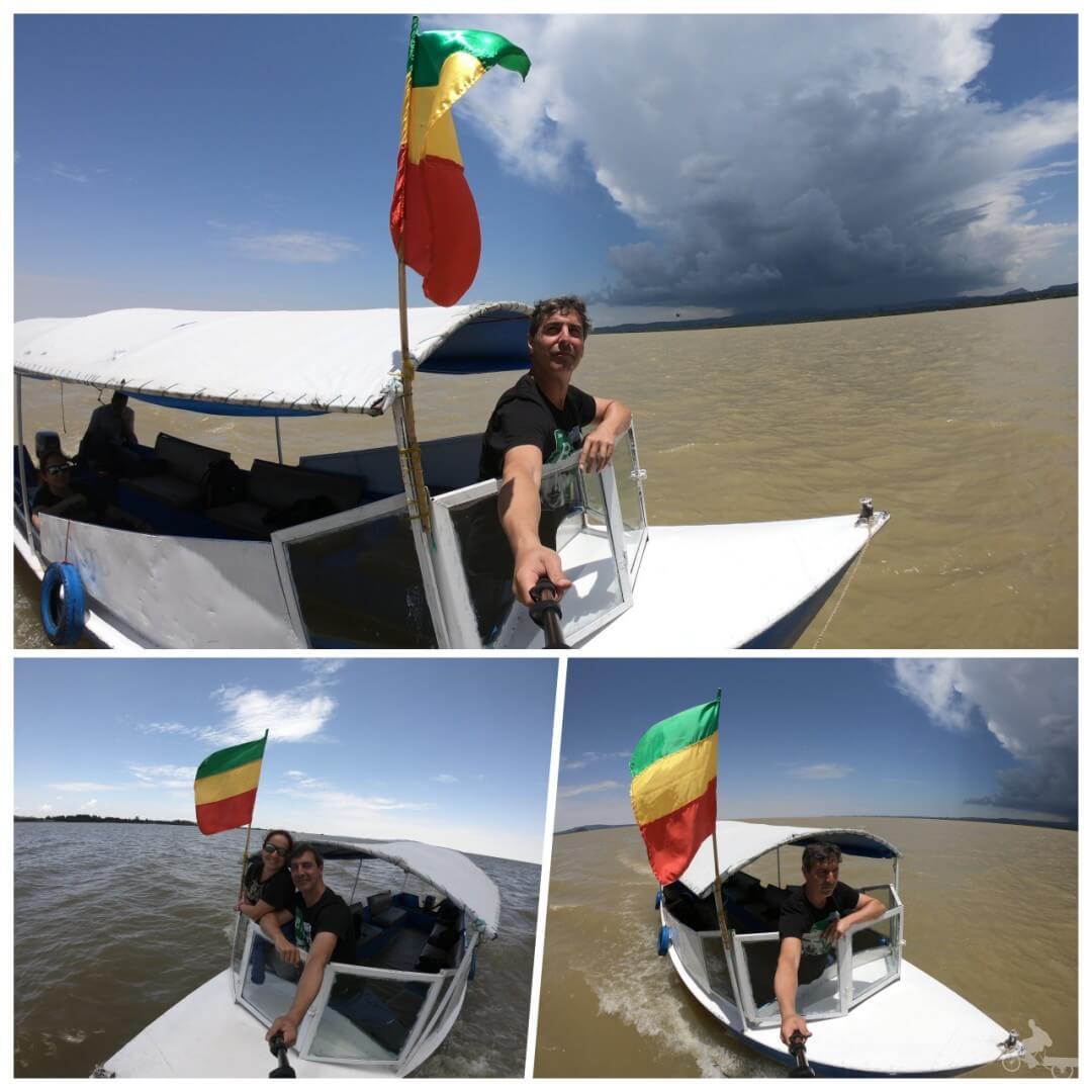 barca navegando lago tana